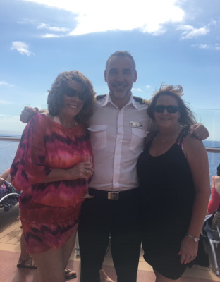 Pam with the Captain of the Celebrity Reflection on Med Cruise
